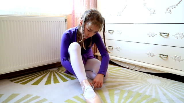 Young ballerina wearing pointe shoes video