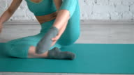 Young Ballet Dancer Stretchs Her Leg And Showing Techniques On Training video