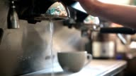 Young barista preparing coffee in a cafe video
