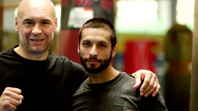 Young beard boxer near bald sparring partner video HD video