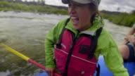 Young, beautiful Asian woman screems as she rafts video