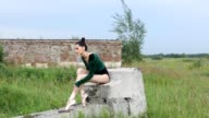 Young beautiful ballerina dancing outdoors in a summer field. Ballerina Project. video