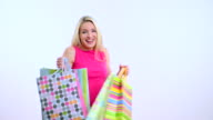 Young beautiful blond woman with shopping bag video