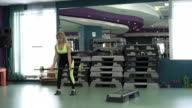 Young beautiful fitness girl exercising in the gym. video