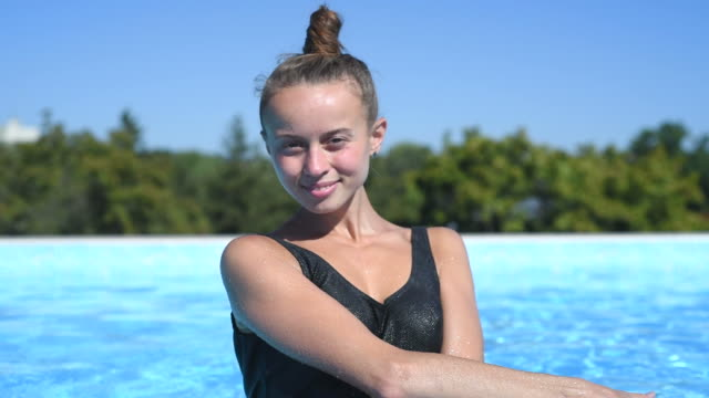 young beautiful girl in the outdoor pool video