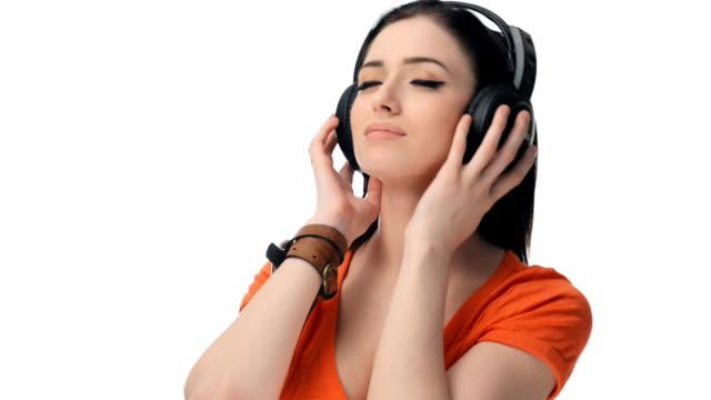 Young beautiful girl   listening music headphones video