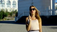Young beautiful girl smokes electronic cigarette video