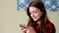 Young Beautiful Girl Uses Smartphone video