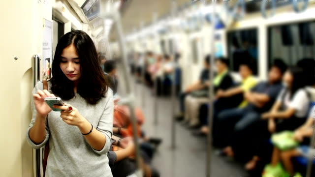 Young beautiful girl using smart phone video