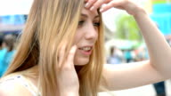 young beautiful happy hipster girl, park of amusement, talking on phone video