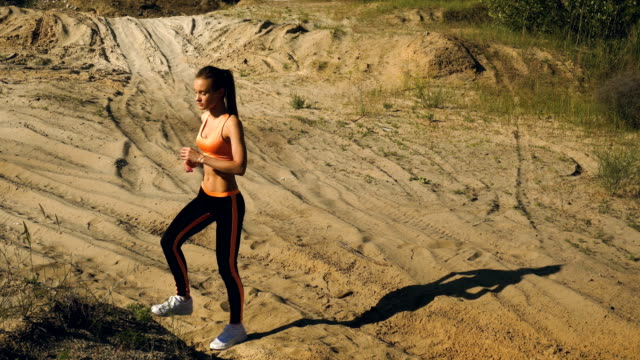young beautiful lady makes sports exercices video