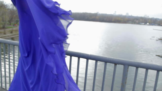 Young beautiful lady posing for camera on bridge, sweet sadness video