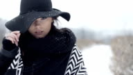 Young beautiful model posing in winter scenery. video
