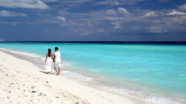 Young beautiful newlyweds on beach video