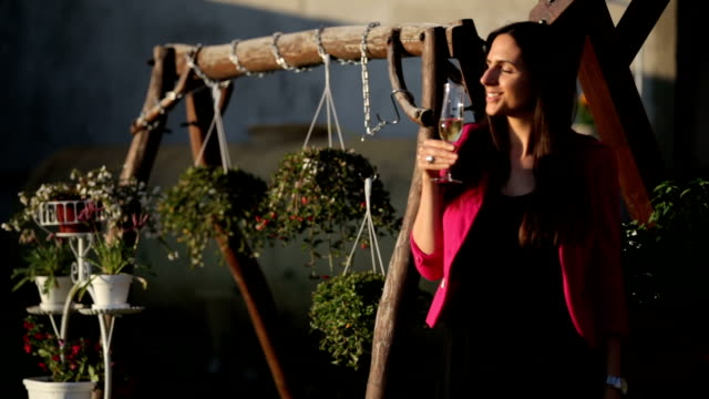 Young beautiful woman drinking wine video