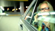 Young beautiful woman in the car video
