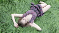Young beautiful woman on the wet green grass video