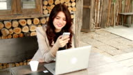 Young beautiful woman using her mobile phone video