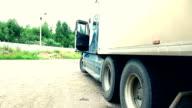 Young beauty girl walk near lorry truck video