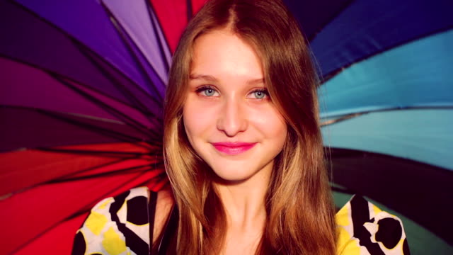 young beauty girl with colorful umbrella video