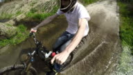 POV Young biker riding on a dirt road video