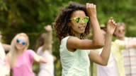 Young biracial singer dancing, singing on set of music video, fame, popularity video