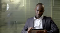 Young black male professional at work video
