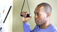 Young black man doing physical therapy on arm or shoulder video