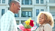 Young black man surprises girlfriend with flowers video