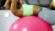 Young black woman working out in fitness club video