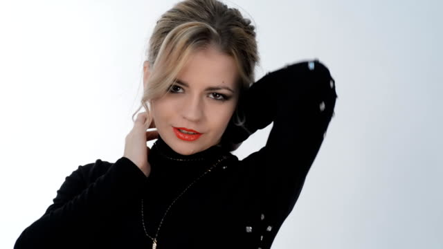 Young blond girl posing in studio video