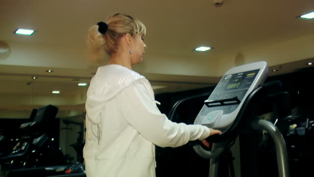 Young blond woman at fitness center video