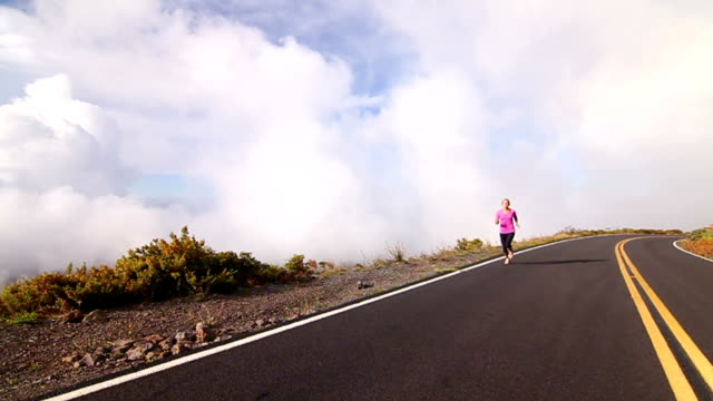 Young Blonde Female Running Above Clouds video