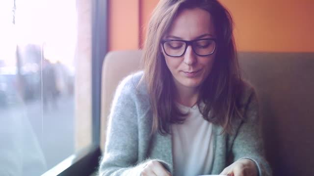 Young blonde woman having a break. video