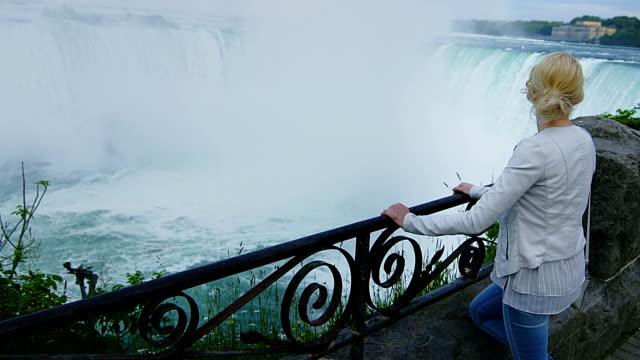 Young Blonde Woman Looking at the Niagara Falls video