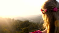 Young boho girl looking at mountains video