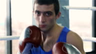 Young boxer looking at camera video