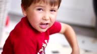 Young boy annoyed. Child looking to camera upset video