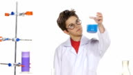 Young boy chemist wearing uniform, red shirt and round glasses in  laboratory making some experiment and wonders on white background, slow motion video