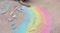 Young boy coloring with sidewalk chalk video