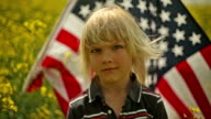 young boy displays his flag video