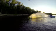 Young boy doing tricks on a wakeboard. Slow motion. video