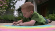 Young boy drawing with chalk video