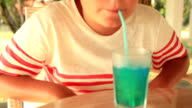 Young boy drinking a summer drink video
