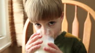 Young Boy Drinking Glass Of Milk video