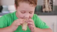 4K Young boy eating a pancake video