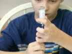 Young Boy Filling Insulin Syringe 1 video