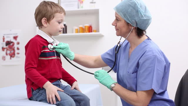 Young boy getting checkup video