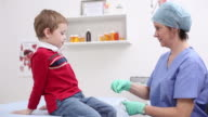 Young boy getting medical checkup video