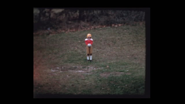 Young boy in football uniform punts football video